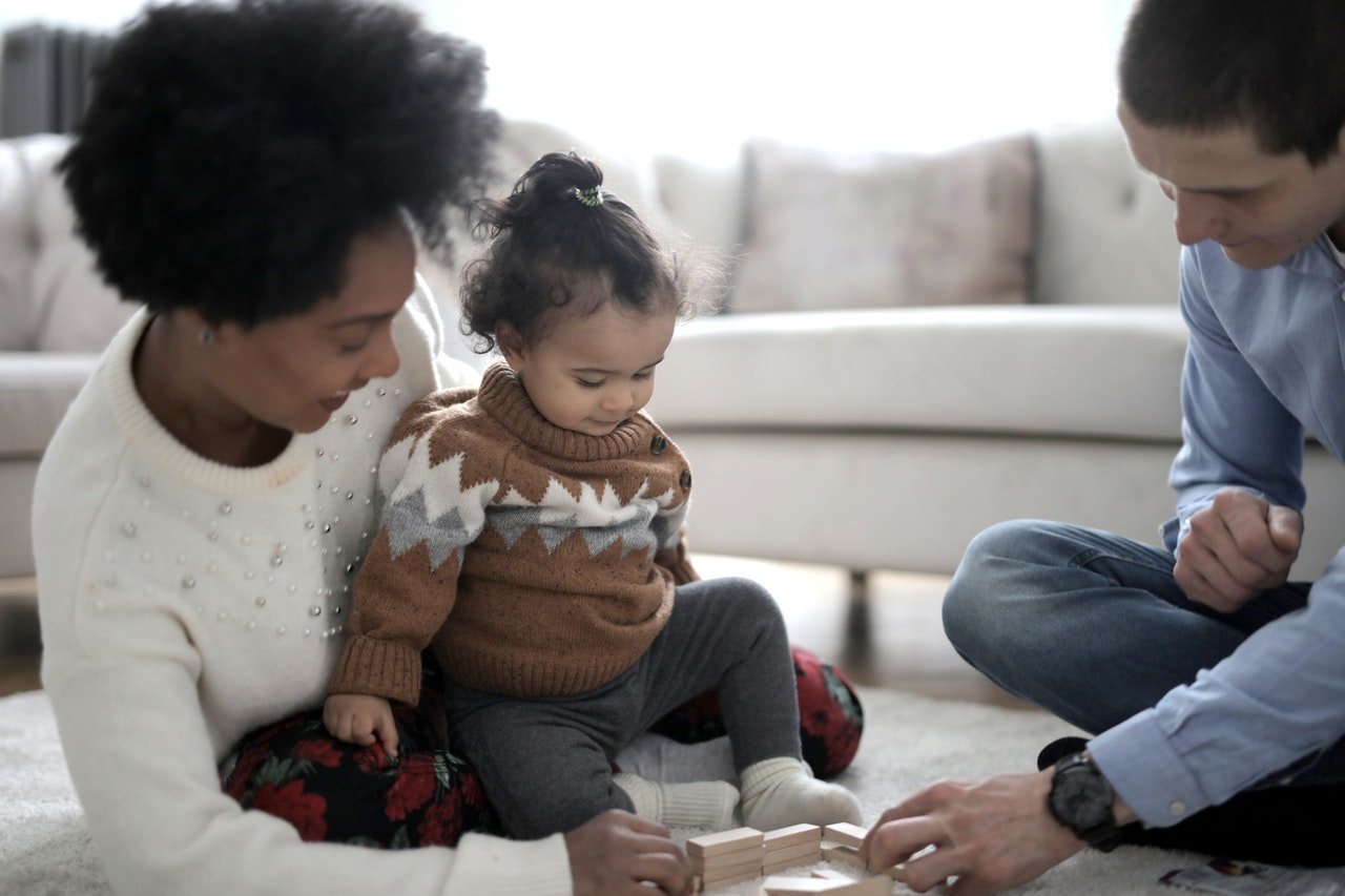 Parents playing with their baby girl