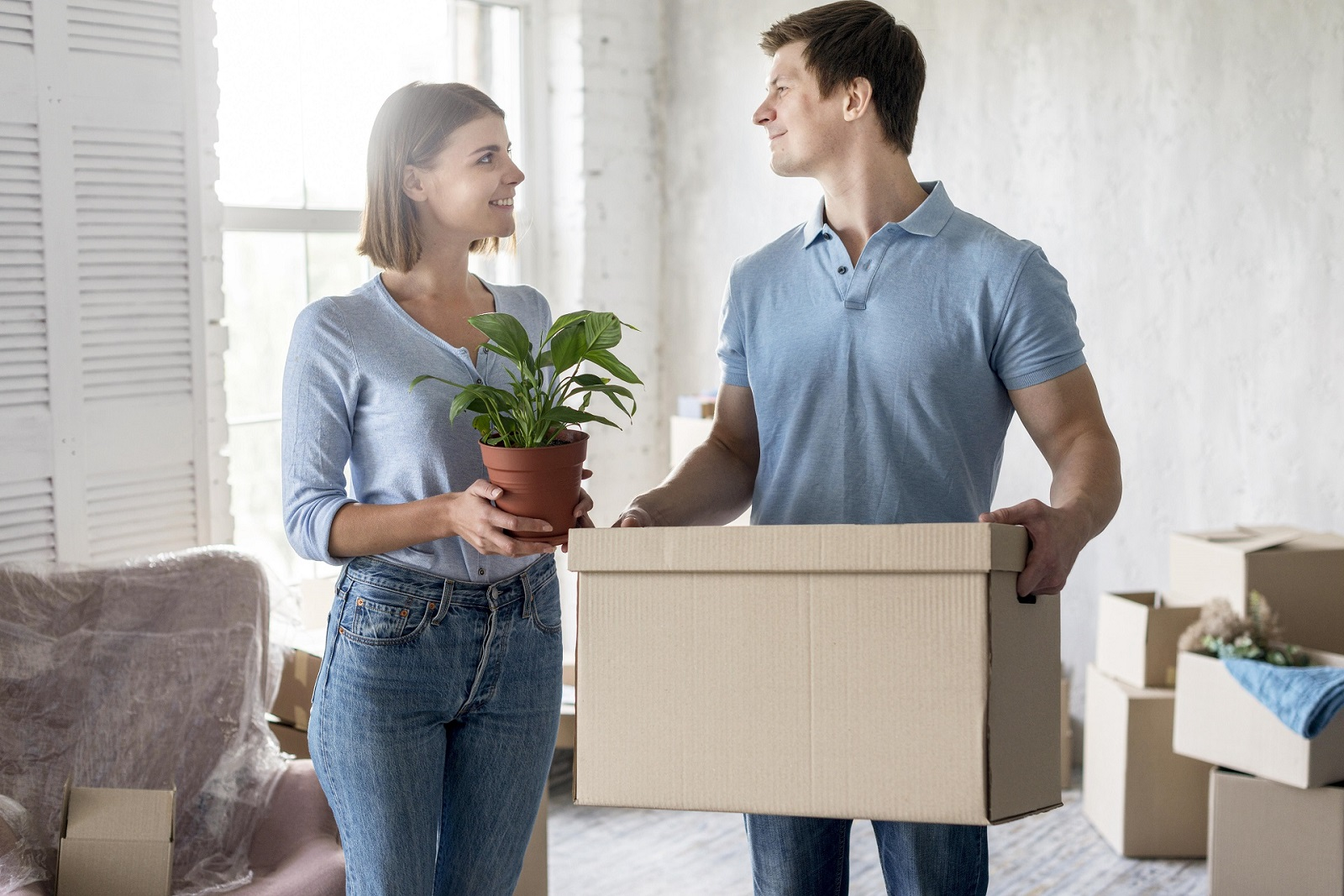 Young couple moving out of their rented home, after they've hired a move out cleaning service