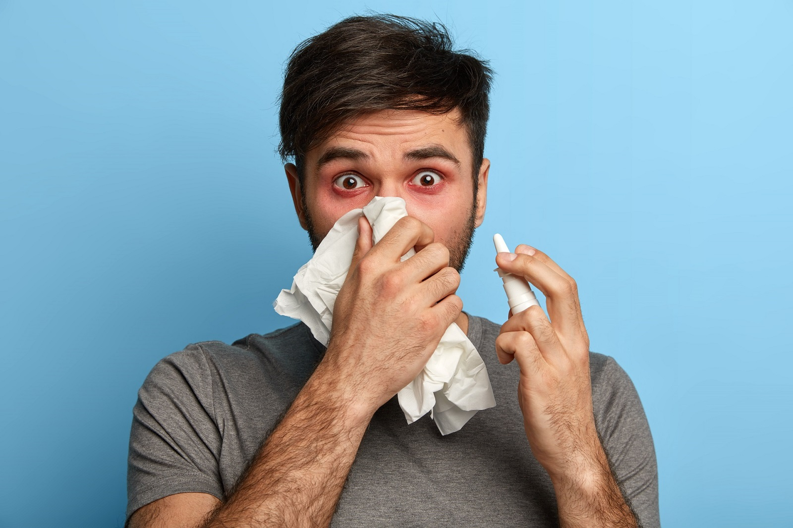 Man suffering from seasonal allergies due to a dusty home. Requires carpet cleaning in his home